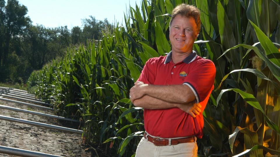 Ken Cassman, an agronomist at Nebraska, stands in a field of corn