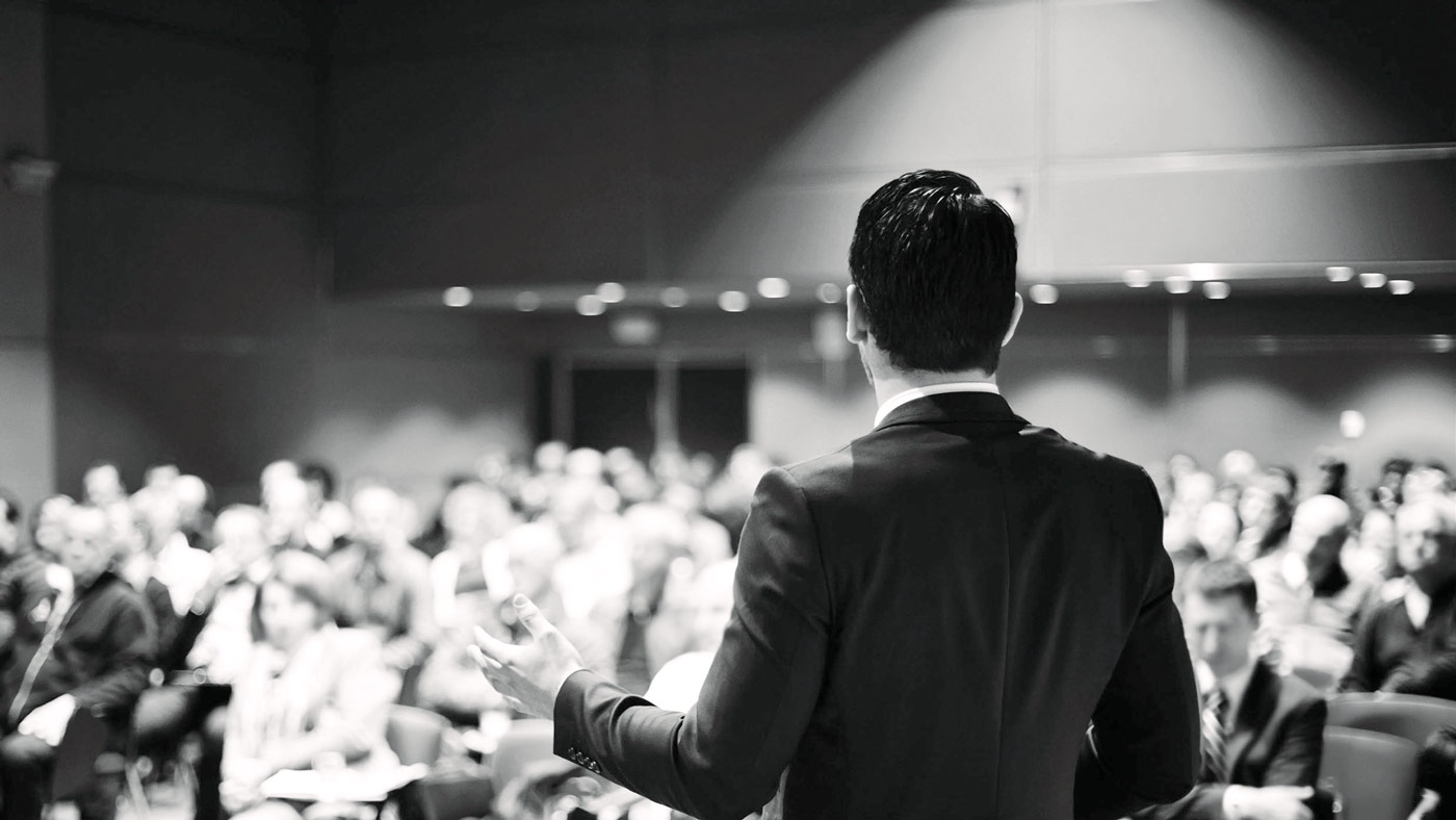 Professional speaking in front of a group