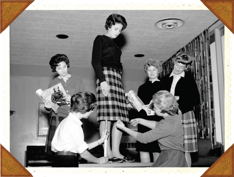Burr Hall Female Residents measuring a skirt height in the 1950s